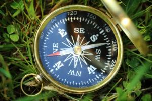Golden compass on green grass